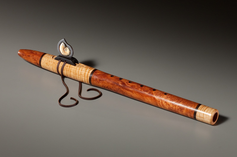 Instrument in the tradition of Native American flute with shell fetish